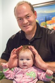 Dr. Darren Pohl with young patient